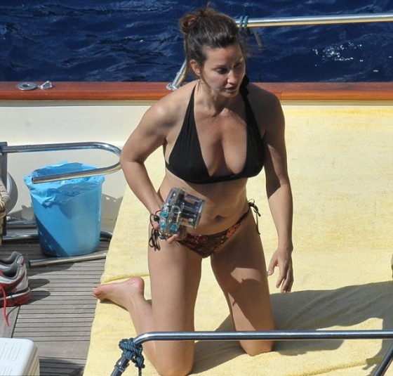 With her athletic body and Dark brown hairtype without bra (cup size 36C) on the beach in bikini